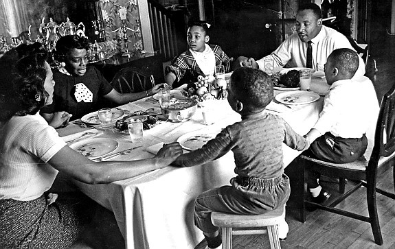 Martin Luther King Jr. eating with his family, source unknown